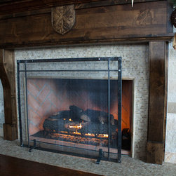 Artisan Studio Series - This custom iron fireplace screen, part of the Artisan Studio Series, a new line of custom, budget friendly goods for the home, gives just the right feeling of rustic charm in this contemporary home.