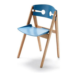 We Do Wood - We Do Wood Dining Chair No.1, Blue - The chair is a simple but elegant composition of several fitted pieces. The seat is rimmed with an abrupt incline inspired by old-fashioned metal dustpans, whose form represents both strength and practical use. A rounded back with two symmetric keyhole shapes carved into the frame enhance the three dimensional experience of the chair, and add lightness and air to its feel.