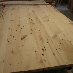 Nantucket reclaimed lumber heart pine counter top - Here is a picture of the lumber above all processed, de-nailed, planed and glued up in a slab fr the ktichen island top. The top still needs to be finish sanded and stained!