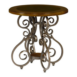 "Hammary - Homestead Round End Table - A beautiful mixture of traditional design elements with a Mediterranean appeal. Turned legs, seeded glass and metal accents add more beauty to each piece. Crafted of Birch Solids & Veneers in an Antique Brown finish with Antique Brass Metal & Glass.. Homestead Round End Table; Wood Top with Leather Insert; Metal Base; Dimensions: 24""W x 24""D x 25""H"