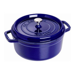 Staub - 4-Qt. Round Dutch Oven - The French oven is a timeless standby for stews, roasts, soups, casseroles and other one-pot classics. Staub has perfected this tradition in our signature ''La cocotte'' (co-cot) French Oven, the choice of some of the world's best chefs. The traditional round design has self-basting spikes for continuous, natural basting. When your meal is ready, La Cocotte moves beautifully from the stove to your table. Features: -Round cocotte.-Material: Cast iron.-Nickel knob for oven use.-Closed circuit and spikes cooking allows self basting.-Enameled black matte interior provides genuine flavor.-Smooth enamel bottom.-Constant and optimum performance.-Cast iron retains and evenly diffuses heat.-Induction hob compatible.-Lid features self-basting spikes for continuous, even distribution of juices throughout cooking.-Perfect for stews, roasts, soups, casseroles and other one-pot classics.-Easy to clean.-Dishwasher safe but it is advised not doing this too often.-Resists up to 500 F.-Compatible with all heat sources.-Staub provides lifetime guarantee.-Made in France.-Capacity: 4-Qt..-Distressed: No.-Country of Manufacture: France.Dimensions: -Dimensions: 5.7'' H x 14.4'' W x 10.2'' D.