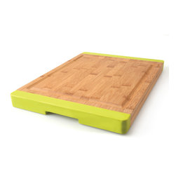 "Berghoff - Berghoff Pro Bamboo Chopping Board - Chopping board features lime green silicone accents to prevent skidding and a groove around the board to prevent juices from spilling off. Bamboo chopping boards are seeing a resurgence in popularity as they are considered a green product."" Caring for bamboo cutting boards is easy, just wash with soap and water. The natural beauty and durability is unique."