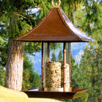 Bamboo Bird Feeder - This Asian-inspired bird feeder would be a great addition to a zen-like garden space. On a more practical note, it's built to last and deter other animals from munching through all yoru bird seed. Save it for the birds.