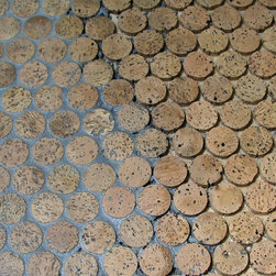 """Penny Round Cork Mosaic Tile Close Up - Penny Round Cork Mosaic Tile Close Up are a versatile, extremely durable, environmentally friendly material made from 100% post-industrial, granulated, and pressed cork by product from the Portuguese wine cork industry. These distinctive 1 inch cork disks ( think of 1/4"""" cut wine stoppers) are then affixed to 12×24 inch interlocking sheets for easy installation like any standard tile. These tiles are in their natural state and can be stained any color or used in wet applications by adding water based polyurethane to the final installation. Cork is a natural thermal insulator with great acoustic properties which are just a bonus to this very good looking distinctive tile. Whether it's commercial or residential, wet or dry, floors or walls, cork mosaic tiles are the do anything and always look stunning tile choice."""