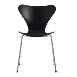 """Fritz Hansen - Series 7™ Chair in Lacquered Veneer - The Series 7 Chair debuted in 1955 at the H55 exhibition in Sweden, and the appeal of what remains one of the most copied chairs of the modern era is its shape. The chair is ideally suited to the human body, its seatback has a comfortable """"give,"""" and its waterfall seat edge doesn't press into legs. Arne Jacobsen, who was instilled with a love of materials, shaped the core of Danish design identity when he accommodated three different bends in one piece of plywood, simply by narrowing the chair back. Once painstakingly made by hand, the Series 7 is now produced using automation methods borrowed from the German car industry and monitored by a team that ensures the authentic Series 7 is perfect every time. Suitable for contract use. Stacks six high. This is the authentic Series 7 Collection by Republic of Fritz Hansen. Made in Denmark. Choose from nine options of Lacquered Veneer, a glossy finish with no visible wood grain."""
