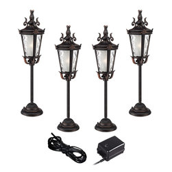 """Super Duty - Traditional Super Duty Casa Marseille 6-Piece Bronze LED Landscape Set - Give your front or backyard stylish accent lighting with this complete landscape lighting set. This kit includes four low-voltage LED path lights with an ornate finial accent a bronze finish and champagne hammered glass. A 45-watt low voltage transformer is included which features a built-in photocell for dusk to dawn operation. A black landscape wire completes the kit so you can connect your lights bringing this set together for a spectacular look. Works with existing low voltage landscape lighting systems.  6-piece set.  From the Super Duty brand of lighting.  4 LED path lights one 45-watt low voltage transformer cable.  Bronze finish.  Path lights include a 3 watt LED.  Comparable to a 25 watt incandescent bulb.  45 watt transformer.  Built-in photo-cell for dusk to dawn operation.  Full ON mode or three AUTO settings (4 6 and 8 hours).  99 feet of cable.  Ground stakes included.  Path lights are 36"""" high 9 1/4"""" wide."""
