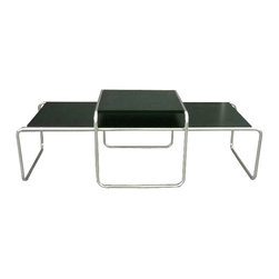 Kardiel Laccio Style Nesting Coffee Table Set, Black - Marcel Breuer conceived the first tubular steel chair, in 1925, based on the tubed frame of a bicycle. The Laccio tables were conceived as companions to the Wassily chair but have become true classics in any decor. Functional, simple and distinctly modern. This exact reproduction of the Laccio table could easily be the last Laccio table you will ever have to buy. No dimension detail was overlooked. Like the original, this reproduction uses materials designed to exceed the structure demands of long term daily use such as the 3mm thick steel frame. Faithfully reproducing this iconic design means including all features of the original, some of which provide durability, some are appearance related and others act as both. This is a reproduction true to the original in design that is built to functionally endure time.
