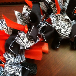"Halloween Ribbon Wreath - This wreath is 16"" across from far ends of ribbon. Made with black, orange, black & white, and black sparkly ribbon. Great for Halloween or to liven up any room. Can be used as indoor decor or front door wreath."