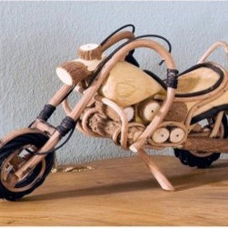 Groovystuff Teak Wood Accent Motorcycle - Close your eyes and imagine riding down the open highway, wind in your hair, motorcycle humming. It's easy to do when you're gazing upon the beautiful hand-carved Groovystuff Wood Motorcycle, which makes a great decoration for home or office.GroovyStuff's Reclaimed Wood FurnitureThe secret to the exquisite beauty of re-claimed wood furniture is simple. All it takes is the time and touch of Mother Nature. Antique farm implements, yokes, plows, sugarcane grinders, and wagons from a bygone era provide the framework for this, well, groovy furniture. Each piece you see is designed for today's lifestyle from yesterday's antiques. The rich colors and tight grains of this aged teakwood and other recycled woods combine to form the unique character and patina of this collection.Suited for both indoor and outdoor use, GroovyStuff furniture will provide the atmosphere and character you need to create a rugged, earthy look. If kept outdoors, your teak collectible will turn silvery gray as only mature teakwood does. These hints of gray add identity to each piece, but can be easily re-nourished with a fresh coat of Briwax once a season or to your taste.