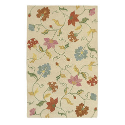 Surya - Hand-tufted Studio Beige Wool Rug (8' Square) - This extraordinarily elegant hand-tufted wool rug is crafted from 100-percent New Zealand wool. This is a versatile rug that can add splendor and an organic quality either indoors or outdoors. The being background is brightened by the colorful flowers.