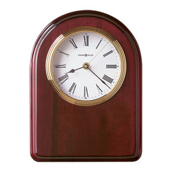 Howard Miller - Honors Desktop Clock - This impeccably created clock is a great gift for the newest college graduate in your family. The rounded edges, rose wood finish, and brass accents are a constant reminder of collegiate success. This clock can be mounted on the wall or set up on a table or desk for maximum exposure. A quartz battery is included so that your favorite graduate can get this beautiful time piece working right away. * Small arch board with high gloss Rosewood finish on select hardwoods and veneers with arched top and profiled edge.. White dial with a brass tone waterfall style bezel and a convex glass crystal.. Brass dowels included for tabletop display, or plaque may be wall mounted.. Batteries included.. Engraved plate not included.. Quartz movement includes battery.. 11-1/2in (29 cm) H x 8-1/2in (22 cm) W x 1in (3 cm) D