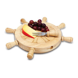 "Picnic Time - Mariner Cheese Board Set - Get the party started with the Mariner! Designed to look like a ship's helm, the Mariner is a great gift for those who love boating. Four cheese tools are secured in magnetic slots evenly spaced on the side of the board, their wooden handles resembling those of a ship's helm. Four stationary handles on the side of the board help to ""steer"" the helm as the board rotates like a mini lazy Susan. Let the Mariner set your party in motion. Includes: 1-9"" round rubberwood cutting board with a thin groove on the top surface to catch whey, brine or juice run-off; 4 tempered stainless steel cheese tools with rubberwood handles: 1 crumbly cheese chisel knife, 1 cheese fork, 1 blunt-tipped cheese knife, and 1 pointed-tip cheese knife"