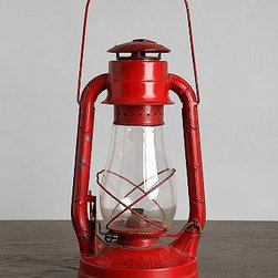 Vintage Kerosene Lantern - This vintage red lantern would be perfect on an entryway table. Or display it on a bookshelf to do double-duty as a bookend.