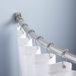 Curved Shower Curtain Rod - The Curved Shower Curtain Rod features a crescent-shaped design that increases space in the shower by adding more elbow room.