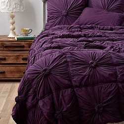 Rosette Quilt, Purple - I love the texture in this bedding, and the rich purples are luxurious and seem like they would be so very cozy on a chilly night.