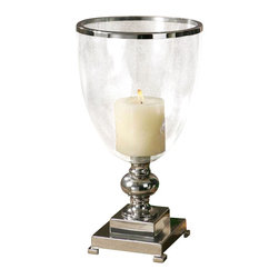 Uttermost Lino Clear Glass Candleholder - Nickel plate with clear glass globe and distressed beige candle. Nickel plated, metal base and accents with clear glass globe and distressed beige candle.