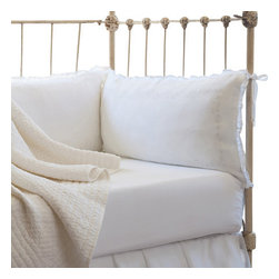 Taylor Linens - Sweetbriar Cream Crib Bumper Set - Delicate flowers are embroidered on exceptionally soft, pure linen. Small ruffles frame the duvet, shams, and boudoir pillows. Each piece is sure to become a much loved heirloom. The crib bumpers are plump and machine washable. Stuffed with baby-safe cluster fiber fillers. Set of four pillows.