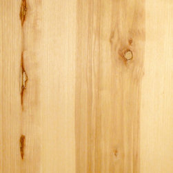 Random Planked Knotty Hickory Veneer - Knotty Hickory is a medium textured veneer with a distinct two toned appearance. Hickory's light sapwood contrasting against the dark heartwood is often used to dramatic effect. Available in a variety of backers and sizes.