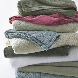 Colorful stack of Coverlets - Michel Arnaud