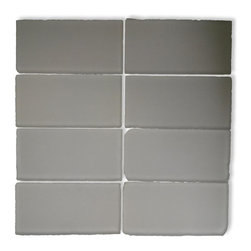 Loft Ice White Frosted Tumbled Edge Glass Tiles - Loft Ice White Frosted 3x6 Tumbled Glass Tile This Ice White subway tiles are decorative and durable, making it a great backdrop with the frosted finish. The tile will give a fresh and clean look. Using a subway tile as a back splash you will add style to your kitchen decor or any decorated room in your home. It will also give it a more distinct look. Chip Size: 3x6 Color: White with a hint of gray Material: Tumbled Edge Glass Finish: Frosted Sold by the Square Foot - (8 pieces per square foot) Thickness: 8mm