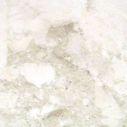 French Vanilla - Looks like a limestone but is a marble, really ethereal and cloudlike, we have used this in a modern kitchen with gray cabinets-gorgeous.
