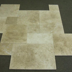 Travertine Tile - This honed travertine tile in a random pattern is great for bathrooms, entryways, mudrooms and kitchens.
