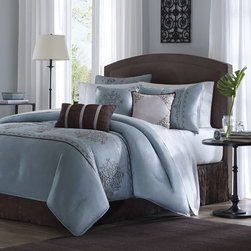 "Madison Park - Brussel 7 Piece Comforter Set in Blue - Brussel is a beautiful bedding collection that is made from a faux silk fabrication. The elegant motif on the bed is all embroidery. This bed looks and feels like true luxury. Features: -Available in Queen, King or California King sizes. -Material: 100% Polyester. -Color: Blue. -Dupioni with embroidery. -Made from a faux silk fabrication. -Elegant motif on the bed is all embroidery. -Dimensions: 90""-104"" Height x 90""-92"" Width."