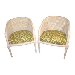 Pre-owned Vintage Off White Faux Bamboo Chairs - A Pair - Get ready for the summer! An elegant pair or vintage faux bamboo arm chairs in off white enamel. These chairs are carved wood faux bamboo with caned backs and side panels and upholstered (removable) seats. The caning is original and in perfect condition. These chairs are freshly enameled and newly upholstered in a lovely green geometric pattern. They are sturdy and comfortable and are waiting for a new home in your sun room or anywhere you want to relax this summer.  As these chairs are vintage, the previous owner custom made wood seat bottoms to ensure a sturdy place for the cushions.  Not noticeable.