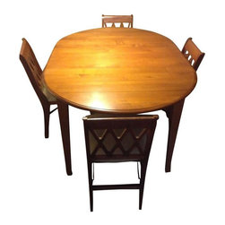 """Used Ethan Allen Dining Table with 4 Chairs - Very versatile Ethan Allen drop-leaf cherry wood dining room table with extension leaf. This table sits 4 without the extension leaf and extends to seat 6 comfortably with the leaf. Could even fit up to 8! The table is in very good shape.  The 4 chairs are in good condition. They fold and have an upholstered seat cushion.    The table measures 42"""" round, and 60"""" x 42"""" when extended."""