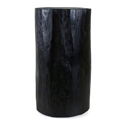 Pfeifer Studio - Lacquered Stump Table - This ebony stump would make a striking side table or nightstand in the bedroom. Can't you see a pair being the perfect modern-rustic foil to the low-lying platform beds that are trending right now?