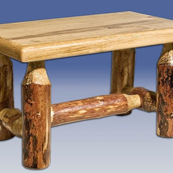 """Montana Woodworks - Glacier Country Log Footstool - Handcrafted. Laminated top. Hand peeled lodge pole pine legs. 20 years limited warranty. Made from solid american grown pine. Hand-crafted in the US, each Montana Woodwork product is made from unprocessed, solid wood that highlights the character of its source tree with unique knots and grains. Made in USA. No assembly required. 16 in. W x 10 in. D x 10 in. HA versatile piece of rustic decor, the log footstool by Montana Woodworks is a very popular item. Use it in conjunction with your rocking chair for a relaxing evening or it can also be used as a step stool for those hard to reach places. Finished in the """"Glacier Country"""" collection style for a truly unique, one-of-a-kind look reminiscent of the Grand Lodges of the Rockies, circa 1900.  First we remove the outer bark while leaving the inner, cambium layer intact for texture and contrast.  Then the finish is completed in an eight step, professional spraying process that applies stain and lacquer for a beautiful, long lasting finish."""