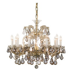 """Inviting Home - Maria Theresa Crystal Chandelier (Traditional Crystal) - honey and gold Maria Theresa style crystal chandelier; 26"""" x 25""""H (11 lights); assembly required; 11 light cut premium crystal chandelier with mouth-blown cut components and Honey plated cut crystal chandelier trimmings; all metal parts have gold finish; genuine Czech crystal; * ready to ship in 2 to 3 weeks; * assembly required; This chandelier is a part of Maria Theresa Collection. At their start the chandeliers bearing the name of Maria Theresa were made on the occasion of the Empress's coronation as queen of Bohemia in 1743. This fact is hidden in the shape of these lighting fixtures reminiscent of the royal crown. Their characteristic feature is the arms' typical flat surface clad with glass bars. The bars are fixed to the arms by glass rosettes and beads with dangling cut crystal chandelier trimmings. These ravishing fixtures were inspired by a chandelier made for Maria Theresa in Bohemia in the mid 18th century. However not only the empress became fond of it; so did many others who fancied the style and the majestic manners after her. Typical elements are metal arms overlaid with glass bars and decorated with crystal rosettes. Originally the trimming was made of typical flat drops called """"pendles"""". Today trimmings of various shapes are used. Premium crystal. A sumptuous type of chandelier trimmings. Fire of the rainbow spectrum brilliance limpidity glitter and perfect scattering and dispersion of light - these are their main features resulting from precise cutting using electronically controlled machines but also from high quality crystal containing more then 30% of lead. Traditional mastery and the revealed mystery of the glass substance blend together with modern technologies and first-rate design in each of these unique pieces. Chandeliers dressed with these trimmings of exceptional beauty will lend an air of grandeur to the ambiance even of the most prestigious interiors. The traditi"""