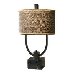 Stabina Table Lamp - Bringing together materials that play with expectations of formality, the Stabina Table Lamp is an artful piece for any room with its mix of tactile rattan on its shade and gleaming black marble at its block foot. The simple bronze frame that unites the two balances the sleekness of the stone with the natural fiber's warmth for a striking composition.