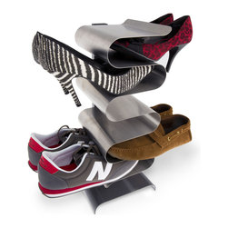 None - j-me Nest 7-pair Stainless Steel Shoe Rack - The Nest shoe rack is a convenient,stylish and space-saving way to store men's,women's and children's shoes. Made of durable stainless steel,this modern seven-pair shoe rack can be installed on the wall or left free-standing on its base.