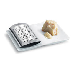 Blomus - SITIO Cheese Grater and Tray - What's a greater treat than cheese? Cheese grated by you, of course! The SITIO Cheese Grater and Tray combo melds two charming pieces in one. Now you can quickly grate your favorite cheeses with the stainless steel grater, and collect every last piece in an elegant tray for instant serving.