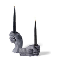 "Grandin Road - Creepy Hand Taper Candle Holder - Halloween Decorations and Decor - Try your hand at decorating with the stone-like creepy hand taper candle holder. Crafted from durable polyresin. Distinctive ""life-like"" details are highlighted by the dark matte gray finish. Fill yours with a real or battery-operated taper candle (sold separately). Each is sold separately. Give the perfect aura to your most haunting Halloween display: our stone-like Creepy Hand taper holders are the perfect addition to your dreadfully delightful dining table or macabre mantel. Each is sculpted to look like a real hand turned to stone, gripping a round candleholder that's made for a realor battery-operated taper candle (sold separately). Complete your tableau with the rest of the Creepy Hand collection; get your hands on the Creepy Hands, Creepy Wall Mount Hand and Creepy Hands Serving Tray.  .  .  .  .  . A Grandin Road exclusive."