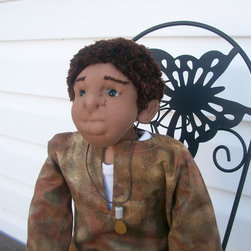 Art dolls for the home and office - Hakim is a wonderful addition to any home.  He can sit on the mantel, in a little chair, on your bed, on a shelf, or he can sit on your couch to give your home a warm feeling.  He comes only in a seated position.  One of a kind art piece.