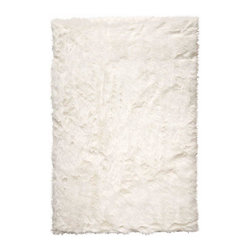 Home Decorators Collection Faux Sheepskin White Area Rug - A glamorous piece at an affordable price, this rug can't be beat. It can be used with any color of upholstery. I'm even using one in a glamorous design project now!