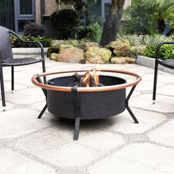 Crosley Yuma Copper Ring Fire Pit in Black - Sophisticated and modern, the Crosley Yuma Copper Ring Fire Pit in Black is great for fireside chats and roasting marshmallows. Its copper-on-steel ring is beautifully contrasted by the black steel frame and bowl, creating an elegant look on any patio or deck. Its oversized bowl allows for longer, warmer fires, while the poker makes it easy to stoke the fire to keep it going. Providing a 360 degree view of the fire, no one will get cold while spending time outdoors during the cool autumn and winter evenings.About Crosley FurnitureIn 1920 Powel Crosley founded the company that pioneered radio broadcasting and mass market manufacturing around the world, starting with a simple radio, meticulously crafted with obsessive detail and accuracy, and a measure of consideration for the wallet. These high ideals have served the company well for over 90 years, and they live on in the newest addition to the family. Crosley Furniture sets a new standard for innovation, function, and meticulous craftsmanship in the manufacture of value-priced furniture. They proudly offer durable furniture products featuring hardwood and veneer construction with rich multi-step finishes in a multitude of styles.