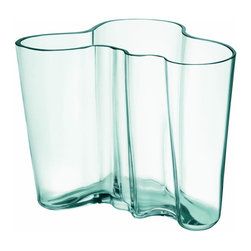 """Iittala - Aalto Vase 6.25"""", Water Green - The beautifully curved lines of this glass vase deserve to take center stage in your home. Fill the vessel with long-stemmed flowers or leave it empty, but find a place for this to be admired. Just imagine it elegantly anchoring your foyer or dining table."""
