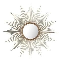 Petite Gold Burst Wall Decor - I'm still not over sunburst mirrors. This mini version from Pier 1 is super affordable, and I adore the braided trim.