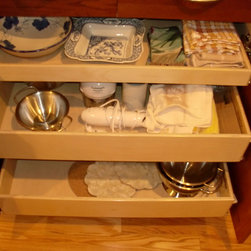 Pull Out Shelves for Your Kitchen Cabinets - Custom pull out shelves to fit your existing cabinets and closets from ShelfGenie of Massachusetts.