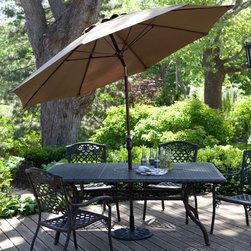 California Umbrella - California Umbrella 11-ft. Fiberglass Double Vent Tilt Sunbrella Market Umbrella - Shop for Patio Umbrellas from Hayneedle.com! Additional features: Flexible fiberglass ribs w/ reinforced joints for maximum wind resistance 5-year warranty against fading on Sunbrella Not recommended for freestanding use We recommend a base of at least 75 lbs. for use with a table Reliable durability is finally paired with the design sense that you want in your backyard or bistro with the California Umbrella 11-ft. Wind Resistant Patio Umbrella. Designed for maximum functionality in the face of the elements this umbrella has a corrosion-resistant powder-coated aluminum pole reinforced rib joints and flexible fiberglass ribs. Traditional wooden-ribbed umbrellas lack the ability to flex in the wind and will break if the umbrella falls over. The sleek collar-tilt system allows you to adjust the angle of your umbrella in one simple motion. The double wind-vent style canopy prevents strong winds from picking up your umbrella so you won't have to chase it down the street. Standing 102 inches high your umbrella can easily provide shade for patio dining tables up to 72 inches wide. With so many fine features you can be sure this umbrella is designed to stay looking good through intense use not just one or two balmy evenings on a quiet back porch. This umbrella is not recommended for freestanding use. We recommend you purchase an umbrella stand of at least 75 pounds or more. All Sunbrella products are backed by a 5-year warranty against fading. Sunbrella fabric is the easiest outdoor fabric to care for! Simply hose off when dirty or dusty and spot clean with mild dish soap and water. About California UmbrellaCalifornia Umbrella is known for producing high-end quality patio umbrellas and frames for over 50 years. The California Umbrella trademark is immediately recognized for its standards in engineering and innovation among all the brands in the United States. As a leader in the industry California Umbrella strives to provide you with products and service that will satisfy even the most demanding consumers. Its umbrellas are constructed to give the consumer many years of pleasure and its canopy designs are limited only by the imagination. California Umbrella is dedicated to providing artistic innovative fashion-conscious and high-quality products for all your needs. About Sunbrella FabricSunbrella fabric is breathable and water-repellant. If kept dry it will not support the growth of mildew as natural fiber will. It's easy to clean requiring simple dusting off and soap and water. Sunbrella fabrics have been tested to provide up to 98% UV protection depending on depth of color. Whites and lighter colored fabrics provide less protection than darker fabrics. This protective factor is inherent to the product and will not diminish through use or exposure to the sun. Sunbrella furniture fabrics have been awarded the Seal of Recommendation by the Skin Cancer Foundation an international organization dedicated to the prevention of skin cancer. Beautiful and durable Sunbrella fabric is a name you can trust in your outdoor furniture.