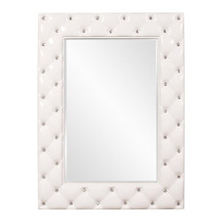 Howard Elliott - Howard Elliott Glamour Tufted Mirror - Glossy White - 34W x 47H in. - 56093 - Shop for Home Furnishings and Accents from Hayneedle.com! The Howard Elliott Glamour Tufted Mirror - Glossy White - 34W x 47H in. complements modern minimalist decors as well as elegant upholstered furniture. This transitional-style mirror features a rectangular shape and can be hung either vertically or horizontally. Its frame is made from beautiful solid resin and features a tufted design with crystal studs. A refreshing glossy white finish anoints the frame. A fine beveled edge accents the smooth mirror edge. Weighs a sturdy 29 lbs.About the Howard Elliott CollectionThe Howard Elliott Collection is one of the premiere manufacturers of decorative mirrors and accessories in the home furnishings industry. Howard Elliott offers innovative designs in a wide variety of styles and the company prides itself on its high standards and quality. No matter your style the Howard Elliott Collection offers pieces that are sure to add sophistication and luxury to your decor.In the company's meteoric rise it now ships to nearly 3 500 furniture home furnishings and lighting retailers as well as many of the top contract companies servicing the hotel and building industries worldwide.