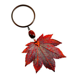 Full Moon Maple Leaf Wine Charm in 24-karat Gold - If you're looking for a quick way to add sparkle and natural beauty, this charm is your Acer in the hole. A natural, full moon maple leaf positively gleams in your choice of either 24-karat gold or iridescent finishes. Hang it atop a wine bottle, use it as a napkin ring, or dangle it from a hook.