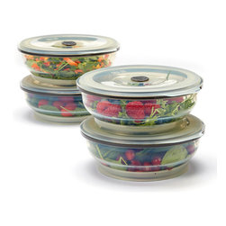 Collapse-It - Collapse-It 6-Cup Food Storage Container - Set of Four - With air-tight lids, this sublime set of 6-cup silicone storage containers keeps veggies, leftovers and more securely sealed and fully fresh! The collapsible construction saves crucial kitchen space when not in use.   Includes four storage containers and four lids 3'' H x 6.5'' diameter Holds 6 cups 100% silicone Toxin-free Freezer-, oven-, microwave- and dishwasher-safe 2-year warranty Imported