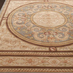 "Horchow - ""Palace Versi"" Rug - As much art as floor covering, this magnificent rug features a large central medallion framed by scrolling-vine motifs and bordered by a twisted-rope design. Hand-carved wool pile. Cotton backing applied with latex. Sizes are approximate. Imported...."
