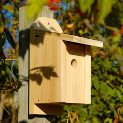 Chickadee Joy Box Bird House - Solid Cypress - This delightful Joy Box Bird House is easy to maintain with its twist latch and slide-front panel that also inverts for winter roosting. It is sized for a variety of bird residents.
