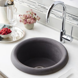 Pozo NativeStone Bar & Prep Sink by Native Trails - Create a stir with Pozo. Its drop-in installation creates a graceful raised profile, showcasing its organic beauty and one-of-a-kind coloration. Boasting a wonderfully functional deep, circular shape, Pozo makes one heck of a sous chef – or bartender.