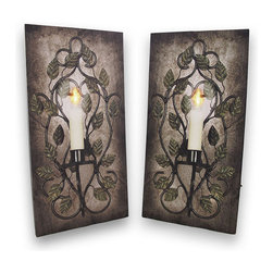 Pair of Flickering LED Sconce Canvases - Add worry-free accent lighting to any wall in your home or office with this pair of printed canvases. Each canvas features an image of a leafy wrought iron sconce with a lit candle, and it has a perfectly placed flickering LED that brings it to life. Each print measures 16 inches tall, 8 inches wide, 3/4 inch deep and has 2 hanging slots cut into the wooden frame so it easily mounts to any wall. The light is powered by 2 AA batteries (not included), are controlled by an inconspicuous on/off switch on the side of the canvas, and unsightly wires are concealed and contained by the vinyl backing. This pair of prints makes a great housewarming gift that is sure to be admired.